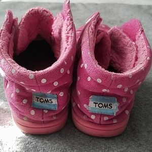 Tom's that are pink polka dotted and fleece lined